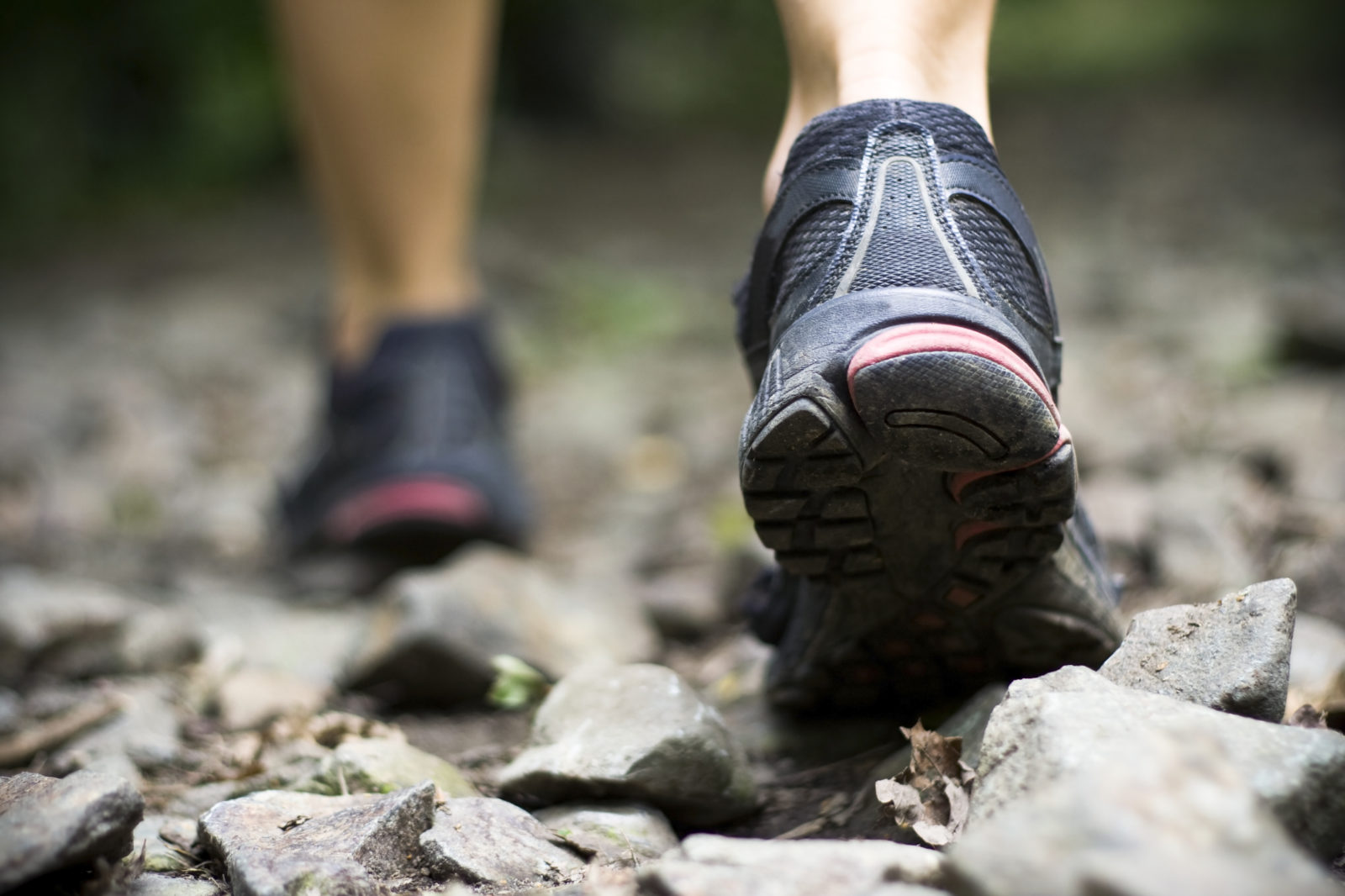 Sport shoes on trail walking in mountains